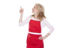 Kvinnlig kock i förkläde arkivbild