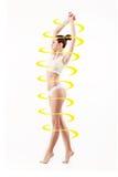 Kvinnlig kropp med pilar för en cirkulering Fett förlorar, sunt äta och näringbegreppet royaltyfri bild