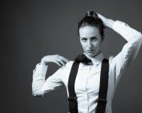 Kvinnlig ledare på manlighet Arkivfoto
