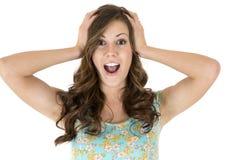 Kvinnlig modell för brunett med ett förvånat eller förvånat uttryck Arkivfoto
