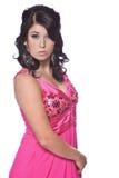 Kvinnlig modell som psing med en vit bakgrund Fotografering för Bildbyråer