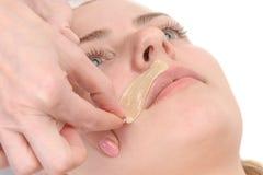 Kvinnlig mustaschdepilation arkivfoto