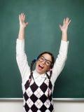 Kvinnlig nerd med lyftta armar Arkivbild