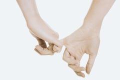 Kvinnlig- och manhänder tillsammans Royaltyfri Bild