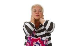 Kvinnlig pensionär med neckache Arkivfoton