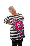 Kvinnlig pensionär med ryggvärk Royaltyfria Foton