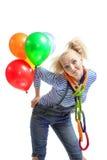 Kvinnlig rolig clown med ballonger Fotografering för Bildbyråer