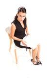 Kvinnlig sekreterare som kontrollerar listan Royaltyfri Foto