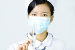 Kvinnlig sjuksköterska med stetoskopet Royaltyfri Bild