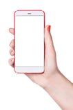 Kvinnlig smartphone i hand arkivbilder