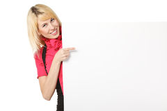 Kvinnlig som pekar till det blanka banret Royaltyfri Bild