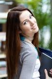 Kvinnlig student med böcker Royaltyfri Fotografi