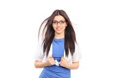 Kvinnlig superhero som river hennes skjorta Royaltyfria Bilder