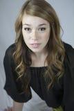 Kvinnlig tonåring som ler litet Fotografering för Bildbyråer
