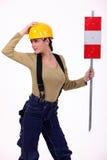 Kvinnlig väg-arbetare arkivbild