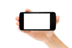 Kvinnliga händer rymmer en mobiltelefon, modellmall bakgrund isolerad white Royaltyfria Bilder