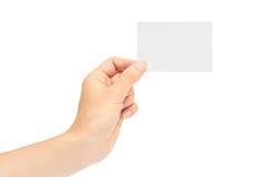 Kvinnliga händer rymmer ett affärskort bakgrund isolerad white Fotografering för Bildbyråer