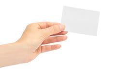 Kvinnliga händer rymmer ett affärskort bakgrund isolerad white Royaltyfri Foto