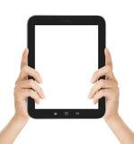 Kvinnliga händer som rymmer en minnestavla, trycker på datorgrejen Fotografering för Bildbyråer