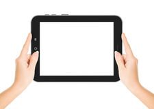 Kvinnliga händer som rymmer en minnestavla, trycker på datorgrejen med Arkivbilder
