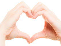 Kvinnliga händer som visar hjärta, formar symbol av förälskelse Royaltyfri Foto