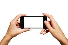 Kvinnliga tonåriga händer genom att använda mobiltelefonen med vit Arkivbilder