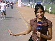 kvinnligjournalistbarn Arkivfoto