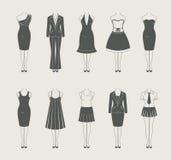 Kvinnligkläder ställde in symbolen Arkivbild
