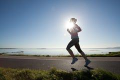 Kvinnliglöpare, maraton Fotografering för Bildbyråer