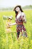 kvinnligmålarebarn Arkivfoton