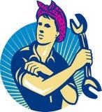 Kvinnligmekanikerarbetare med den Retro skruvnyckeln Arkivbild