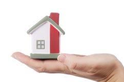 kvinnlign hands huset model white Arkivfoto