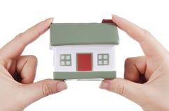 kvinnlign hands huset model white Arkivfoton