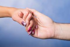 kvinnlign hands manlign Arkivbilder