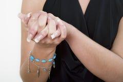 kvinnlign hands s tillsammans Royaltyfri Foto
