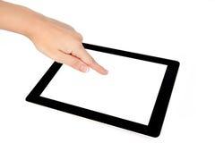 Kvinnlign hands touches skärmen på en tablet fotografering för bildbyråer