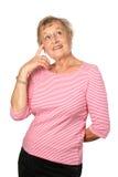 kvinnligpanna henne som pekar pensionären till Royaltyfria Bilder