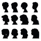 Kvinnligprofiler med olika frisyrer Fotografering för Bildbyråer