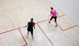 kvinnligspelaresquash två Arkivbild