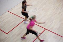 kvinnligspelaresquash två Arkivfoton