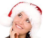 kvinnligstående santa Arkivfoto