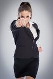 Kvinnligt framstickande Punching At Camera Arkivfoton