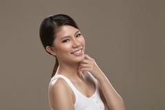 Kvinnligt le för asiat Fotografering för Bildbyråer