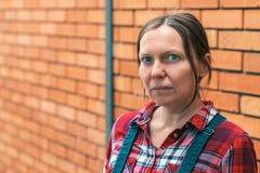 Kvinnligt tänka för bonde royaltyfria foton