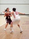 kvinnor för baskethögskola s Royaltyfri Foto