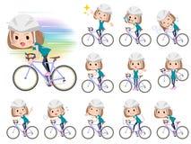 Kvinnor för kläder för egennamnhårgräsplan rider på den red cykeln Arkivfoto
