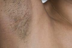 Kvinnor har lotten av hårig armhålasvart och länge Arkivfoton