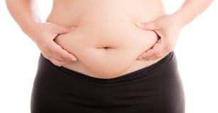 Kvinnor med den feta buken på vit bakgrund fotografering för bildbyråer