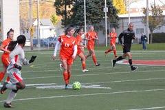 Kvinnors för högskolaNCAA DIV III fotboll Arkivfoto