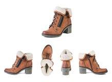 Kvinnors skor på en vit bakgrund, bruntskor, mockaskinn startar Sp Royaltyfria Bilder